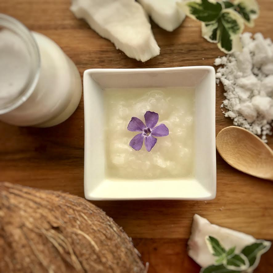 coconut oil with purple flower