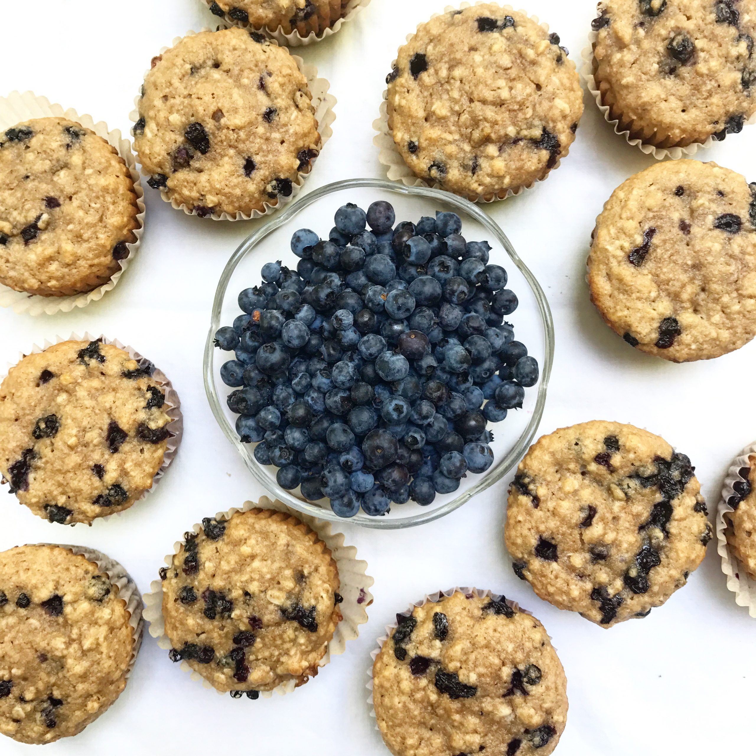 Oatmeal Blueberry Applesauce Muffins and a bowl of blueberries